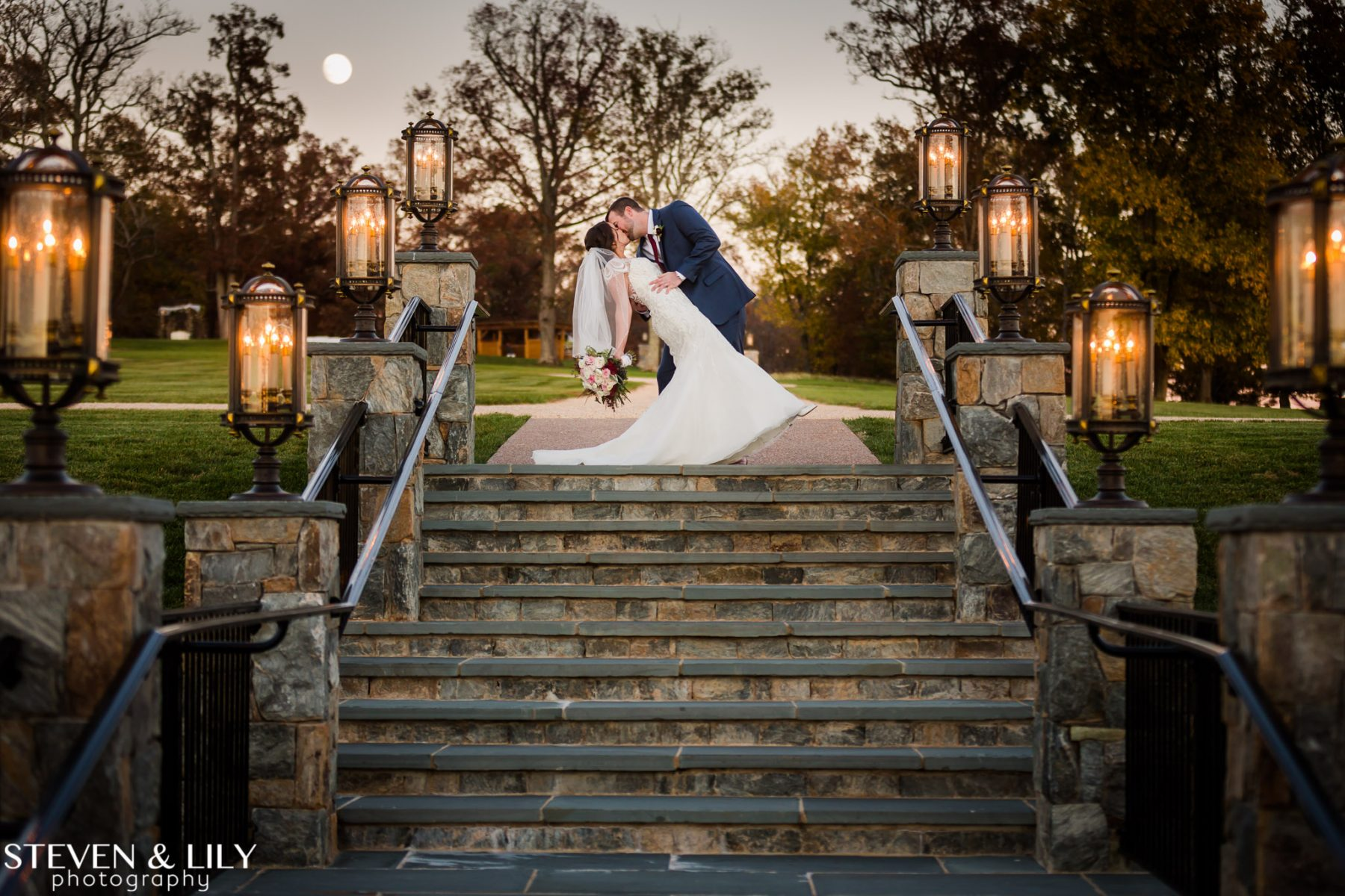Bride and Groom on Stone Stairs at Mount Ida Farm and Vineyard