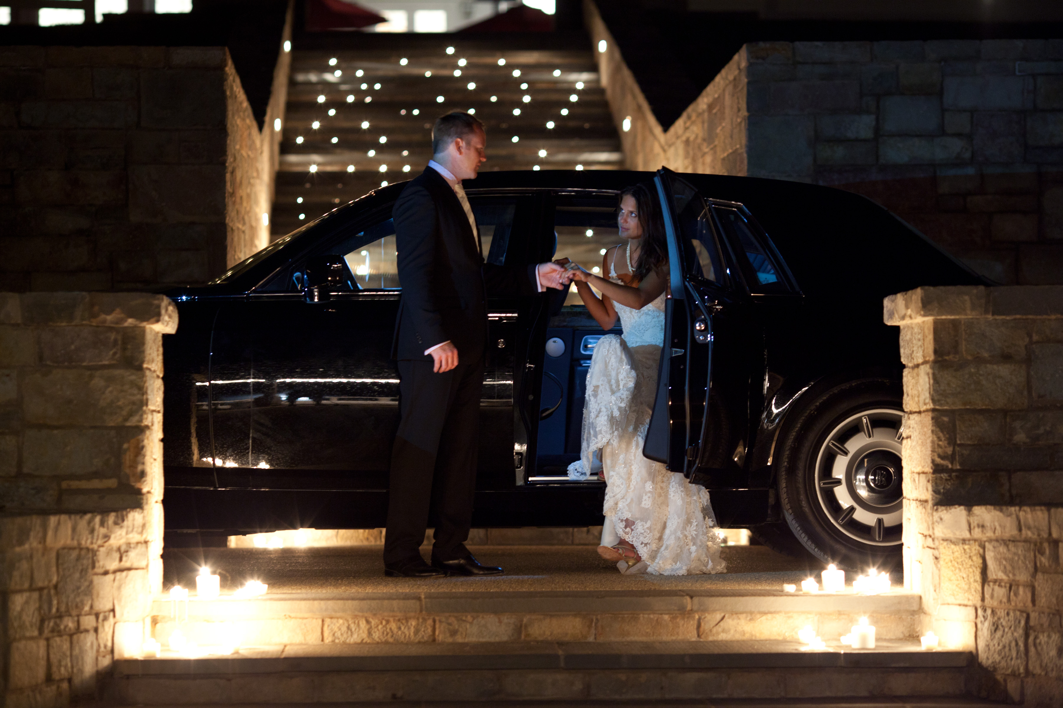 Bride and Groom emerge from Rolls Royce at Mount Ida Farm