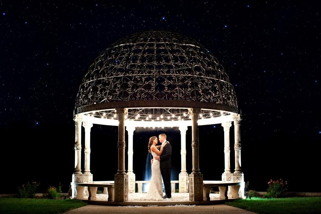 Bride and Groom embrace in wedding gazebo at night at Mount Ida Farm & Vineyard in Charlottesville, Virginia