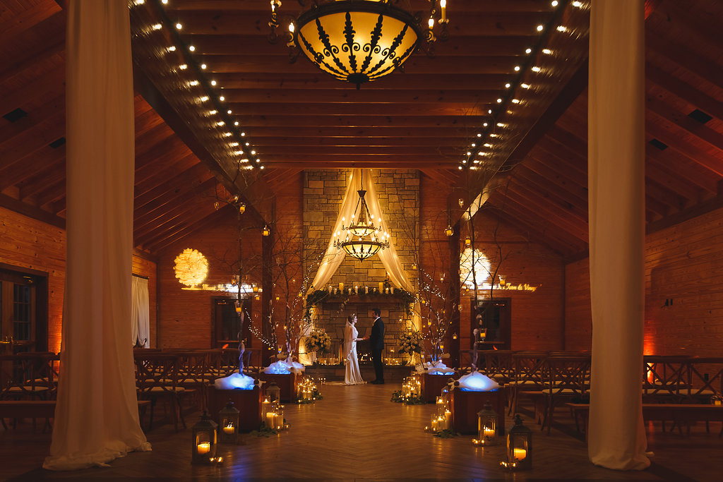 The Barn at Mount Ida Farm and Vineyard Indoor Ceremony (Interior) with church pews and lanterns- Winter Wedding